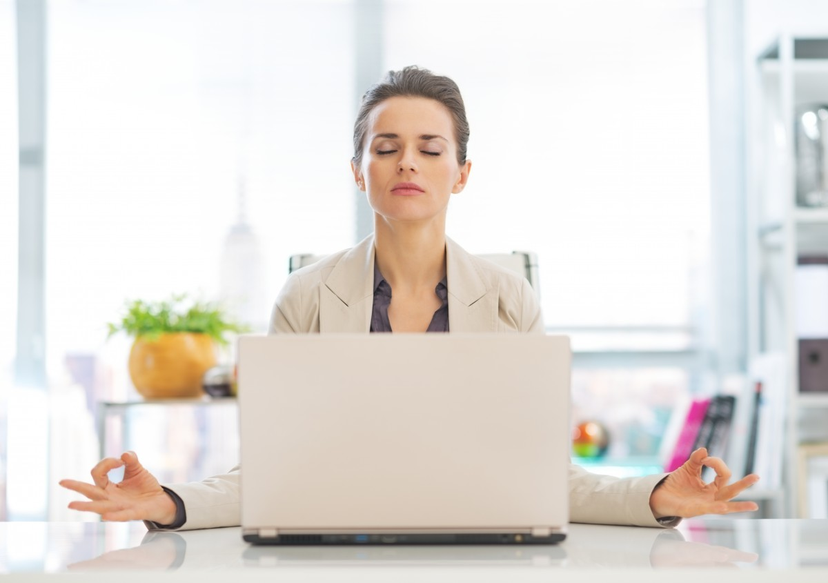 Great Business Woman Meditating Near Laptop In Office, Achieving Workplace Bliss.